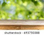 wooden table background   Shutterstock . vector #693750388