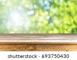 wooden table background   Shutterstock . vector #693750430