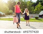 mom and pupil of elementary... | Shutterstock . vector #693757420