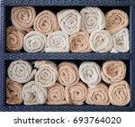 hotel towels rolled in shelf ...   Shutterstock . vector #693764020