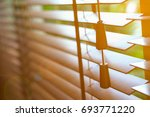 Wooden Blinds With Sun Light...