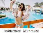 a slim suntanned girl with... | Shutterstock . vector #693774223