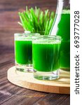 Small photo of Wheatgrass shot. Juice from wheat grass. Trend of health.