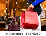 woman in a shopping mall with... | Shutterstock . vector #69378250