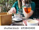 woman drinking alcoholic summer ... | Shutterstock . vector #693843400