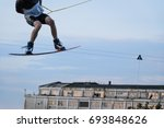 male wakeboarding in a cable... | Shutterstock . vector #693848626