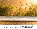 wooden table background   Shutterstock . vector #693876448