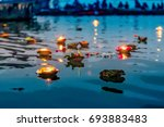 light and flower offerings at... | Shutterstock . vector #693883483