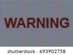 macro shot of word warning... | Shutterstock . vector #693902758