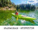 shallow scenic lake kayak tour. ... | Shutterstock . vector #693905734