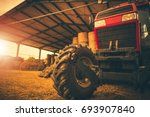 hay storage and the tractor.... | Shutterstock . vector #693907840