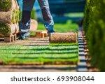 natural grass lawn installation.... | Shutterstock . vector #693908044