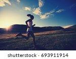 young fitness woman runner... | Shutterstock . vector #693911914