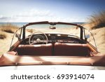 car on beach and summer time  | Shutterstock . vector #693914074