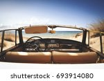 car on beach and summer time  | Shutterstock . vector #693914080