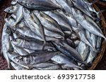 fresh fish in wicker bowl | Shutterstock . vector #693917758