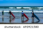 surf lessons. costa rica surf... | Shutterstock . vector #693921580