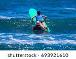 surf lessons. costa rica surf... | Shutterstock . vector #693921610
