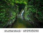 rain forest waterfall thailand | Shutterstock . vector #693935050