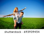 smiling man is holding on his...   Shutterstock . vector #693939454