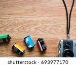 retro camera and film... | Shutterstock . vector #693977170