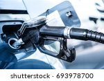 gas station. pumping the fuel... | Shutterstock . vector #693978700
