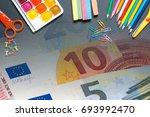 school equipment and money ... | Shutterstock . vector #693992470