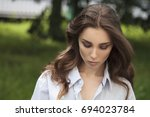 young brunette woman in white... | Shutterstock . vector #694023784