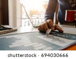 workplace of businesses... | Shutterstock . vector #694030666
