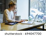 concentrated creative... | Shutterstock . vector #694047700