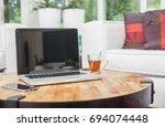 laptop in living room web...   Shutterstock . vector #694074448