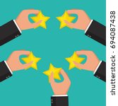hands holding rating star.... | Shutterstock .eps vector #694087438