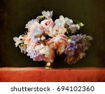 still life flowers in a silver... | Shutterstock . vector #694102360