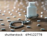 medicine bottle handcuffed and... | Shutterstock . vector #694122778