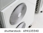 air conditioner compressor... | Shutterstock . vector #694135540