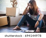 Small photo of stressed young asian woman trying to find money to pay credit card debt.