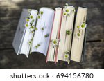 A Stack Of Books With Flowers...