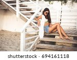 pretty young woman sitting on...   Shutterstock . vector #694161118