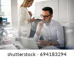two business people working in... | Shutterstock . vector #694183294