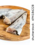 Small photo of Fresh hake fish on the wooden board ready for commercial print for marketplace.