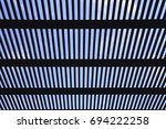 wooden slat roof against the... | Shutterstock . vector #694222258