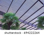 wooden slat roof against the... | Shutterstock . vector #694222264