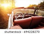 photo of retro cabrio car in... | Shutterstock . vector #694228270
