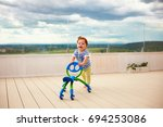 happy toddler baby boy pushing... | Shutterstock . vector #694253086