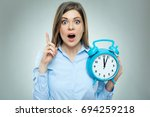 business woman holding alarm... | Shutterstock . vector #694259218