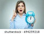 business woman holding alarm... | Shutterstock . vector #694259218