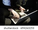 mid age business woman working... | Shutterstock . vector #694263253