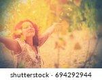 adult brunette woman in a dress ... | Shutterstock . vector #694292944