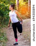 young sporty woman preparing to ... | Shutterstock . vector #694300894