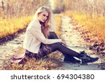 fashion portrait of young woman ... | Shutterstock . vector #694304380